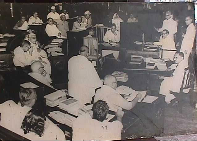 Dr. Ambedkar discussing regarding Hindu Code Bill at New Delhi during 1955. Seen behind him is Mr. Sohan Lal Shashtri