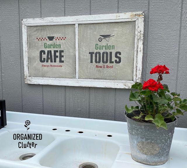 Photo of a stenciled garden sign & zonal geranium