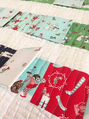 Peekaboo calendar - Christmas Advent calendar made from fussy cut fabric