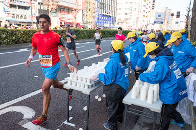 Picking up a drink at the Tokyo Marathon 2017, Asakusabashi, Tokyo.