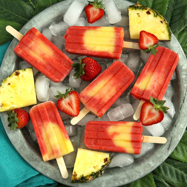 Pineapple Strawberry Swirl Fruit Pops from LoveandConfections.com