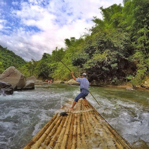 Tinuku Travel Loksado bamboo rafting on Amandit river, a spectacular traditional whitewater adventure in Borneo jungles
