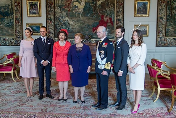 Crown princess Victoria, Prince Daniel, Prince Carl Philip and his wife Princess Sofia welcomed Chilean President Michelle Bachelet. Princess Victoria wore The Fold London Camelot Dress