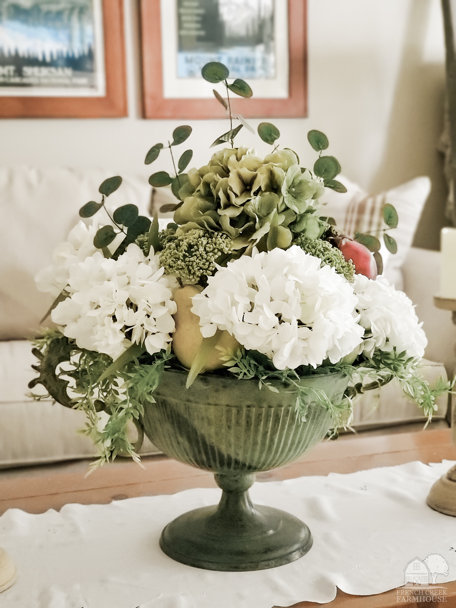 Fall florals and fruits are used to make a large centerpiece