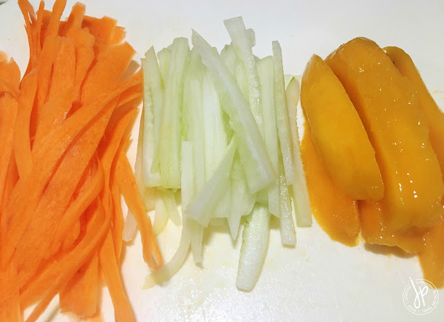Sliced carrots, cucumber, and ripe mango