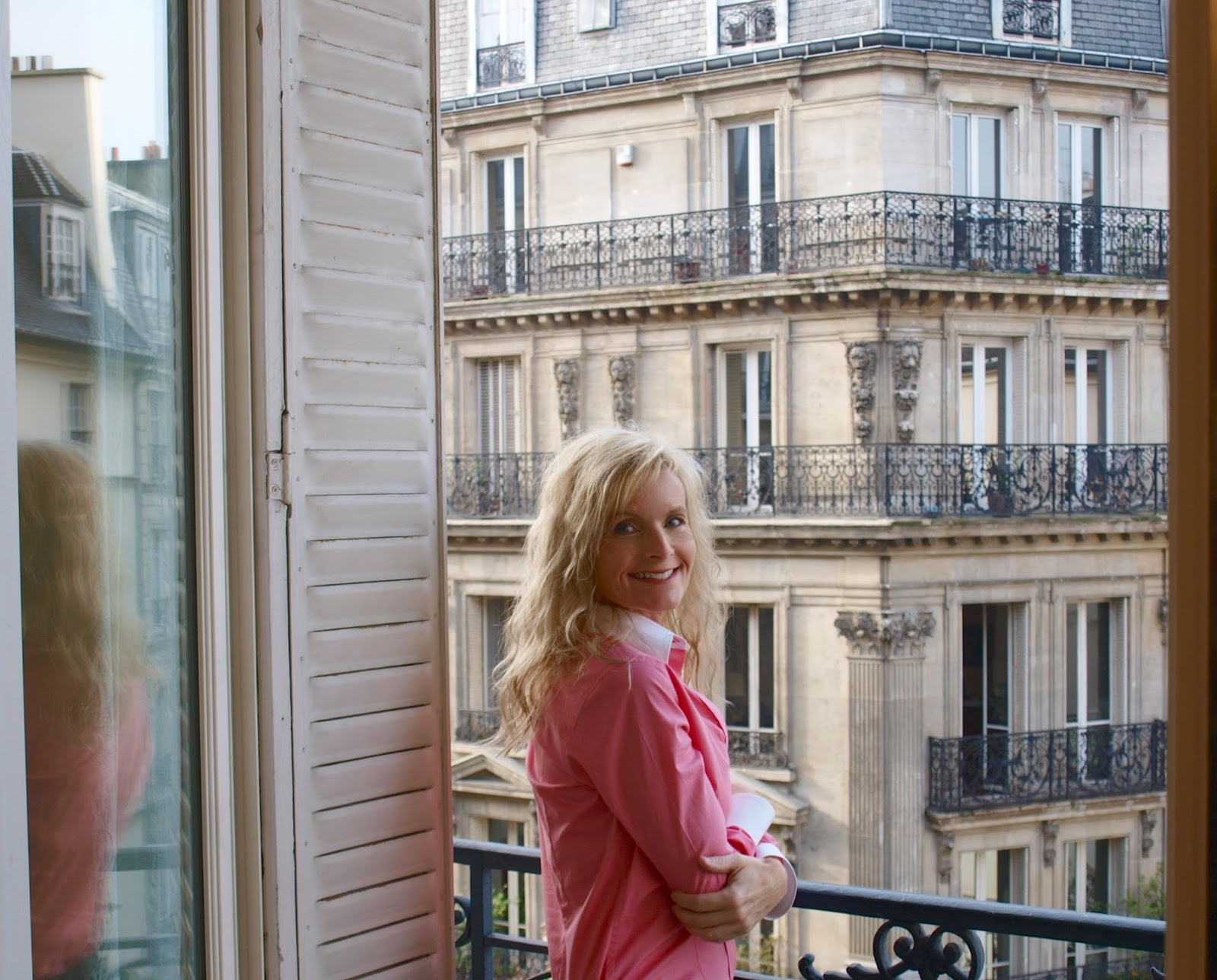 Standing on the balcony of our Paris apartment - Hello Lovely Studio