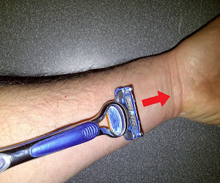 Picture shows how to sharpen disposable razor blade by pushing along arm
