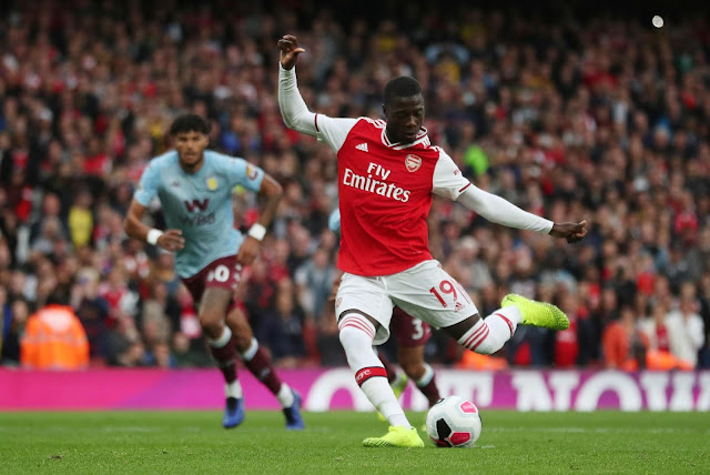 Nicolas Pepe scores against Aston Villa in the Premier League