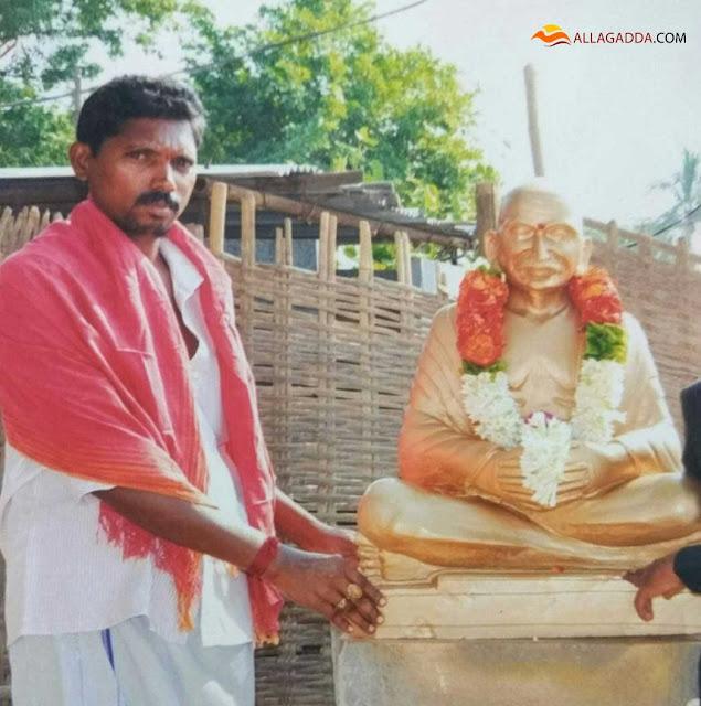 Veeraiah Achari Pulukuri.owner of the shop with gandhi statue