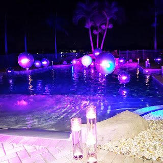 Swimming pool party floating balloons & up-lights