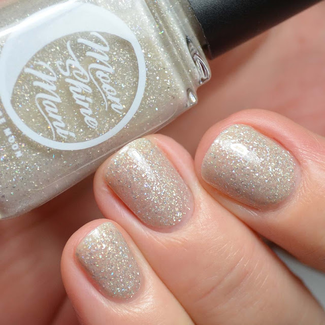 beige crelly nail polish with holographic flakies swatch