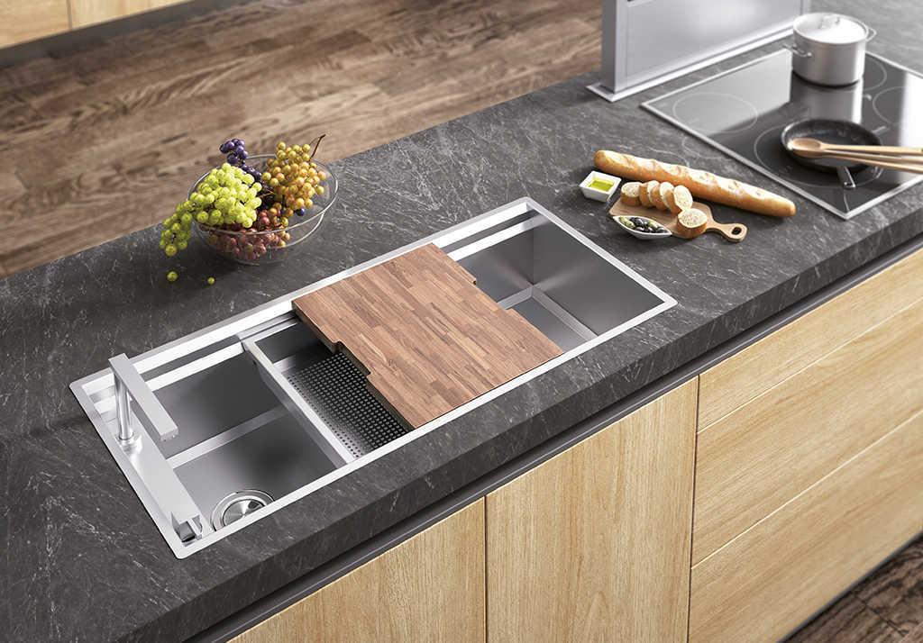 El fregadero de acero inoxidable o de otro material for Mejor material para encimeras de cocina
