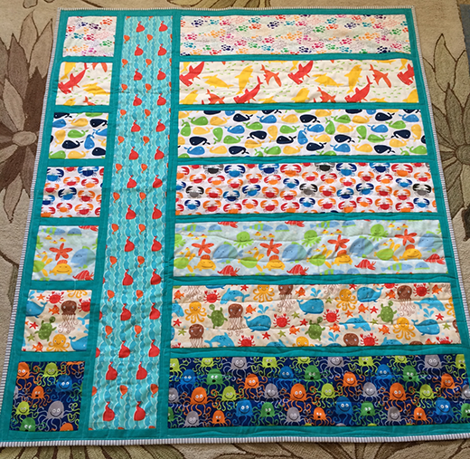 Easy Baby Quilt made by Cation Designs, The Tutorial by Rachel Zupan of One Last Stitch