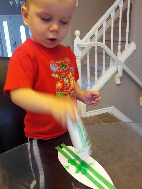 Toddler doing tape resist art