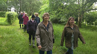 Scottish harp tour group walking in the woods by lock lomond
