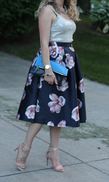 white sequin tank, navy floral skirt, nude heels, blue Clare V. clutch