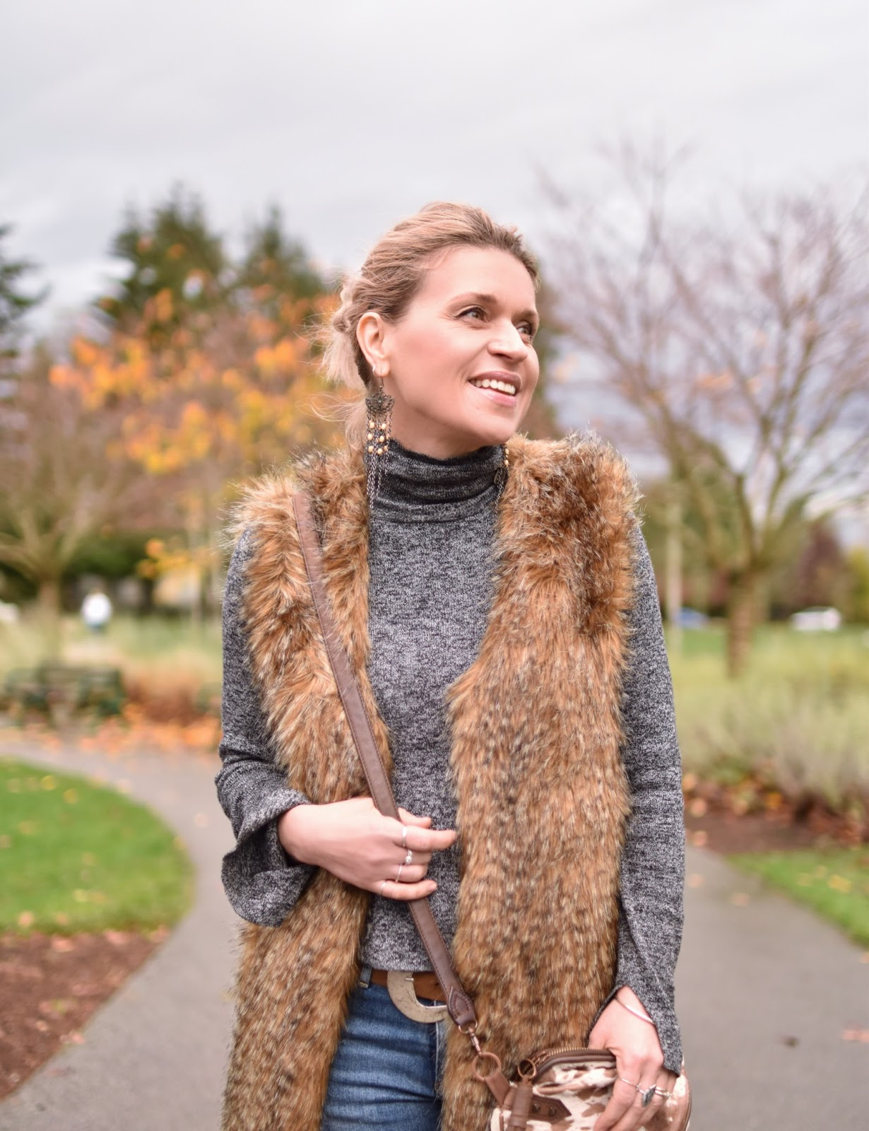 Monika Faulkner outfit inspiration - faux-fur vest, marled grey turtleneck sweater