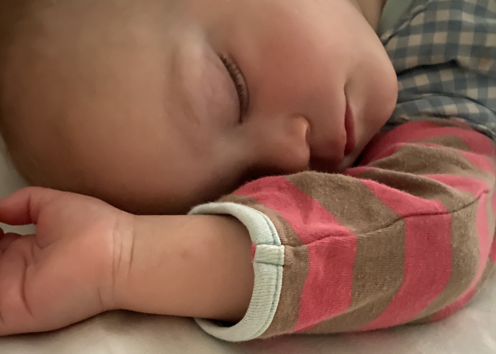 A sleeping toddler co-sleeping in parents bed