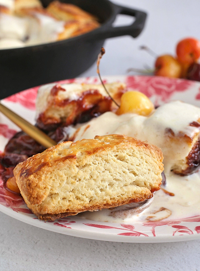 Recipe for a cherry cobbler, baked with a cream cheese biscuit top.