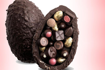 Easter egg stuffed with 3 chocolates, almonds, and hazelnuts