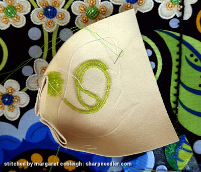 Showing how to keep the two different sizes of green beads separated. (Wild Child Japanese Bead Embroidery by Mary Alice Sinton)