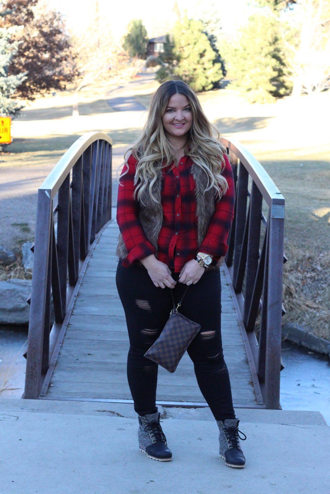 Everyone needs a faux fur vest  by popular Denver fashion blogger Delayna Denaye