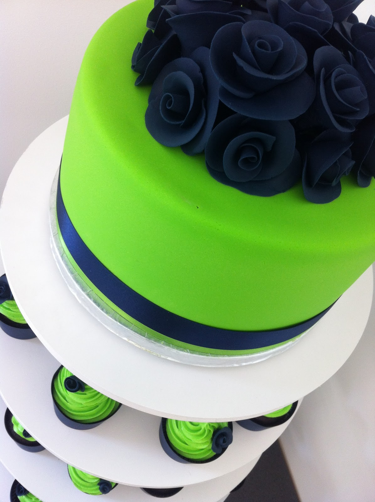 Navy Blue  Lime Green cup cake tower  Kelly Warwick Cakes