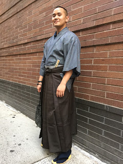 Man wearing traditional jananpese pants hakama.