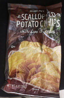 An open bag of Trader Joe's Scalloped Potato Chips with Five Cheeses