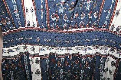 http://www.shein.com/Navy-Split-Tie-Waist-Vintage-Print-Maxi-Dress-p-265045-cat-1727.html