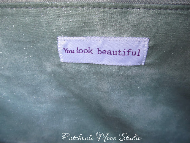 """Label inside bag that reads, """"You look beautiful""""."""