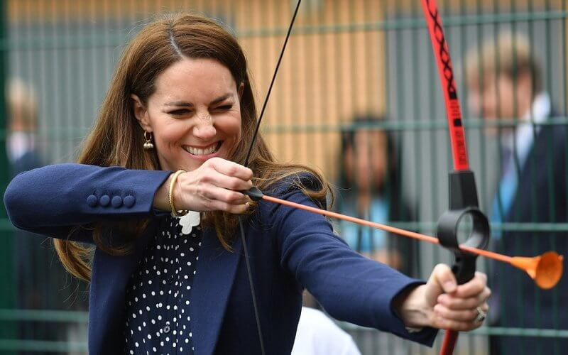 Kate Middleton wore a new polka dot blouse from Tory Burch, and high waisted trousers from Jigsaw. Freya Rose gold hoops with pearls