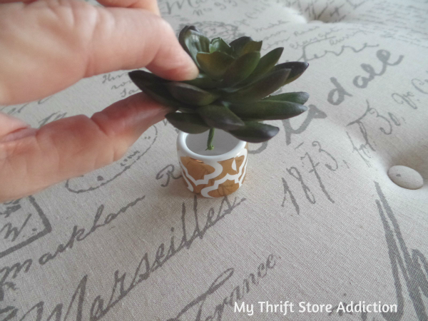 Napkin Ring Mini Succulent Pots  mythriftstoreaddiction.blogspot.com  Clearance napkin rings create perfect tiny pots for succulents!