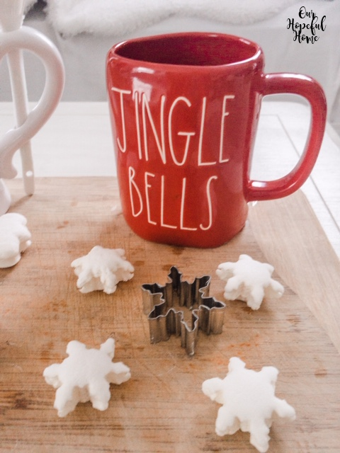 red Rae Dunn Jingle Bells mug marshmallow snowflake hot chocolate topper