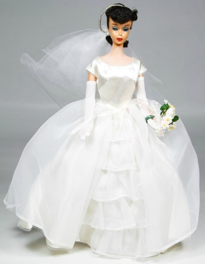 Barbie wearing white wedding dress with gloves, bouquet, and veil