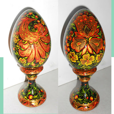 The Easter egg and pedestal in Russian Style Khokhloma in handmade