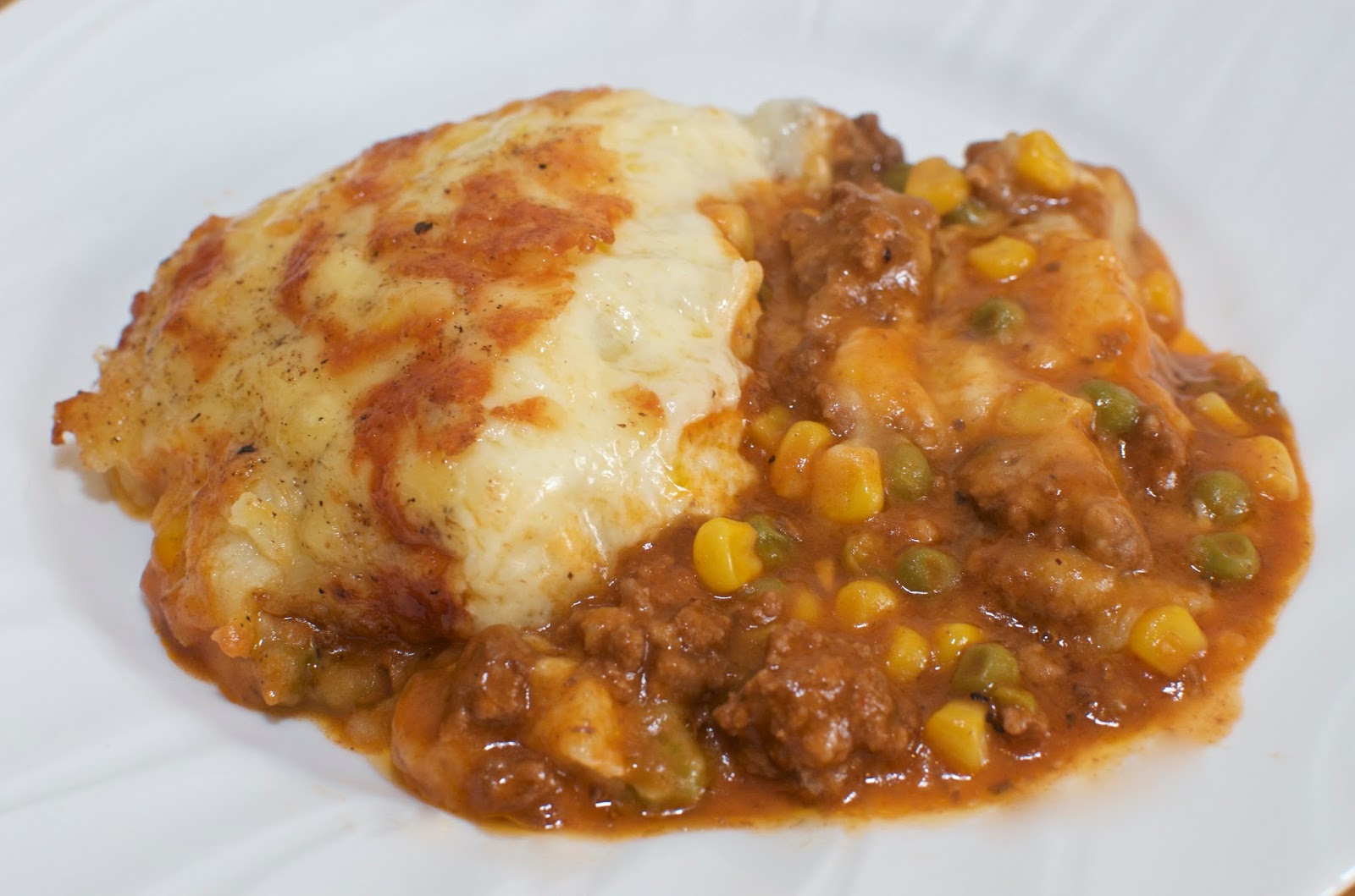 cheesy cottage pie on white plate