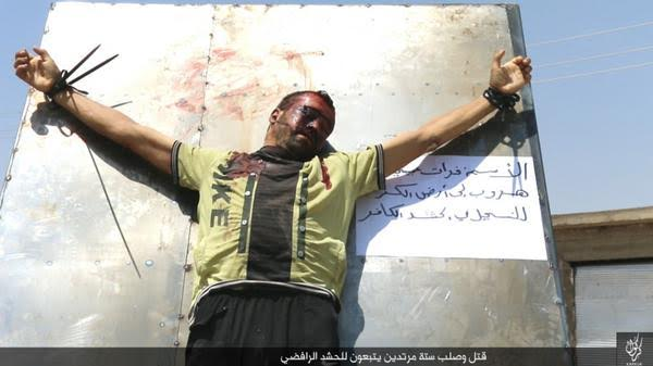 Some photos that show how isis terminate their enemies quite sad to