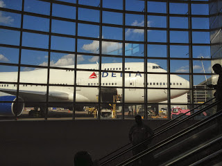 Delta jumbo jet seen through glass windows at an airport in Japan