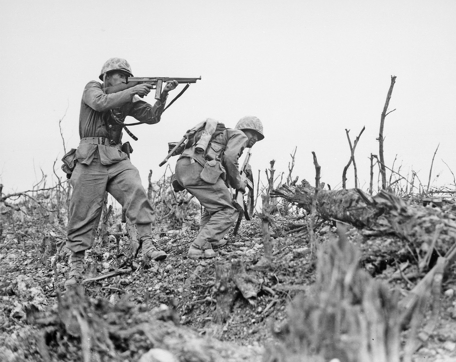 2 world war 2 soldiers cross empty field and shooting guns for blog post about movie the dirty dozen