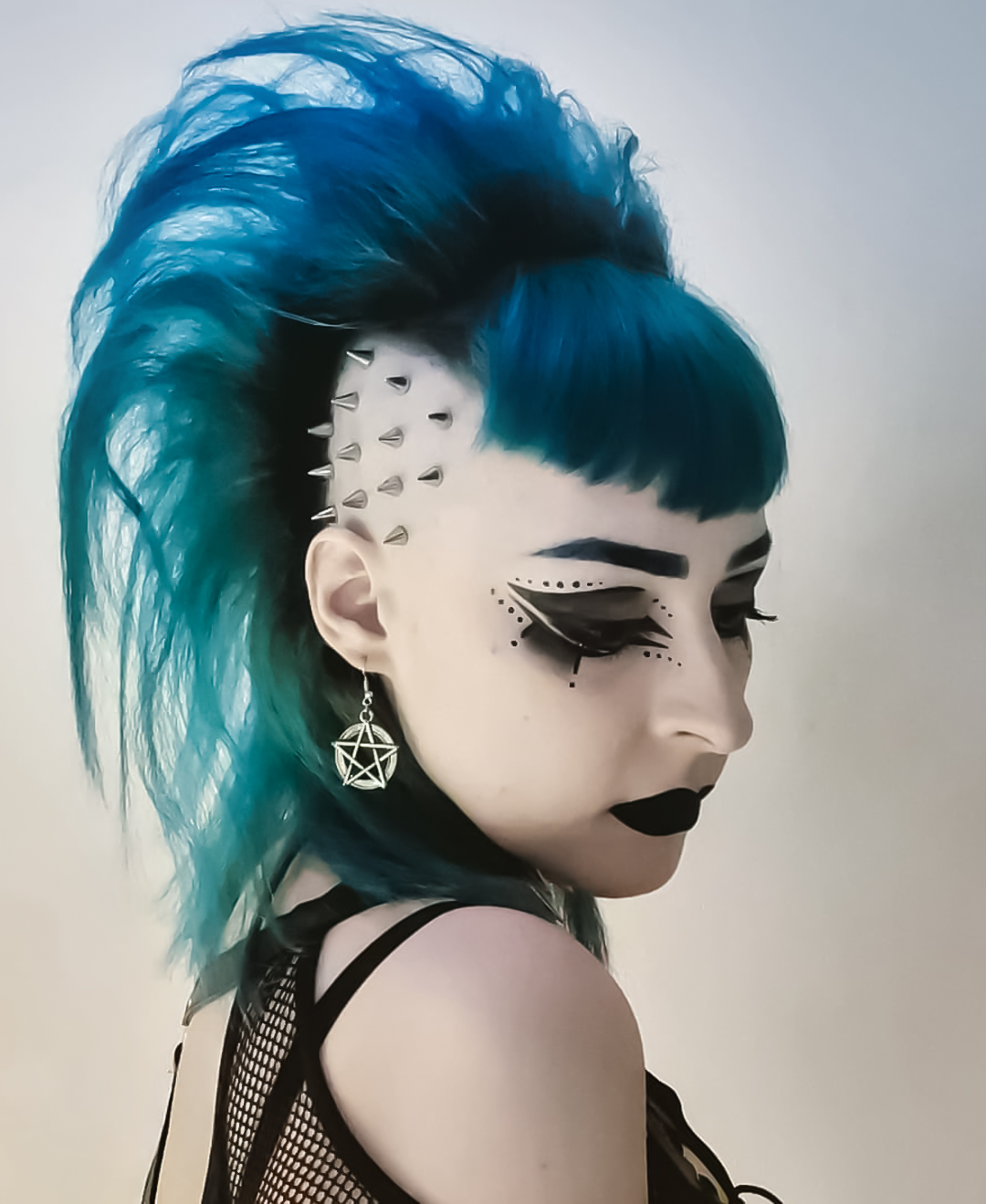 woman with blue and green deathhawk hairstyle