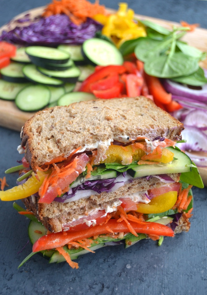 Rainbow Vegetable Sandwich makes the perfect lunch with a mix of rainbow vegetables and a ranch cream cheese spread all on whole-grain bread! www.nutritionistreviews.com