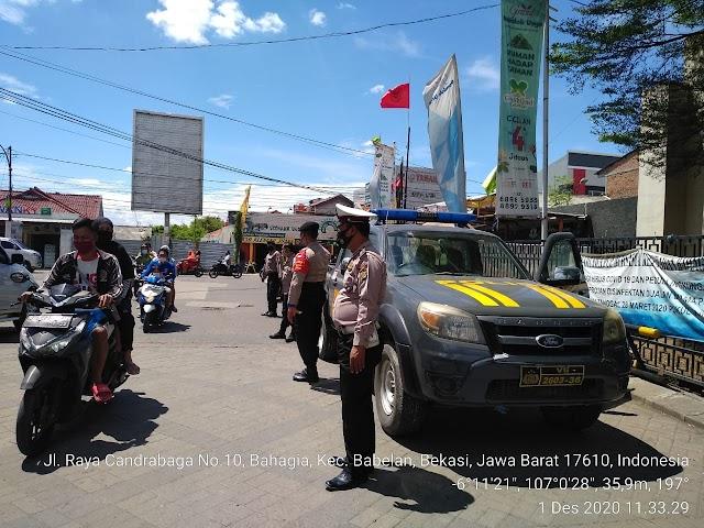 Polsek Babelan Lakukan Penjagaan Guna Antisipasi Pemberangkatan Mobilisasi Masa HRS ke Jakarta .