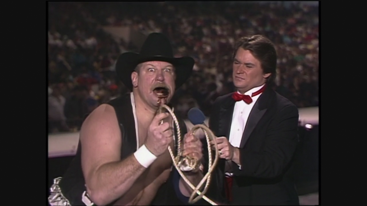 Stan Hansen says words, with a lariat and some chew! Yes! Not as good as his AWA stuff about having a big, fat wife and five billion kids at home who all ...