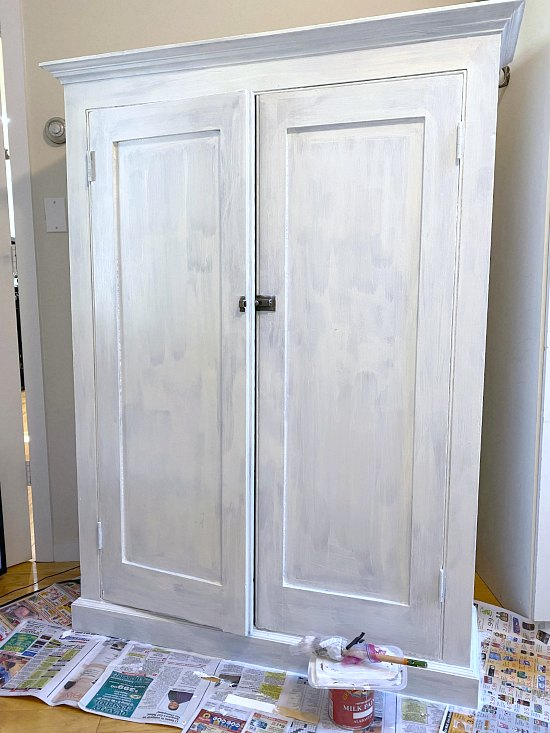 Painting a White Farmhouse Office Storage Cabinet