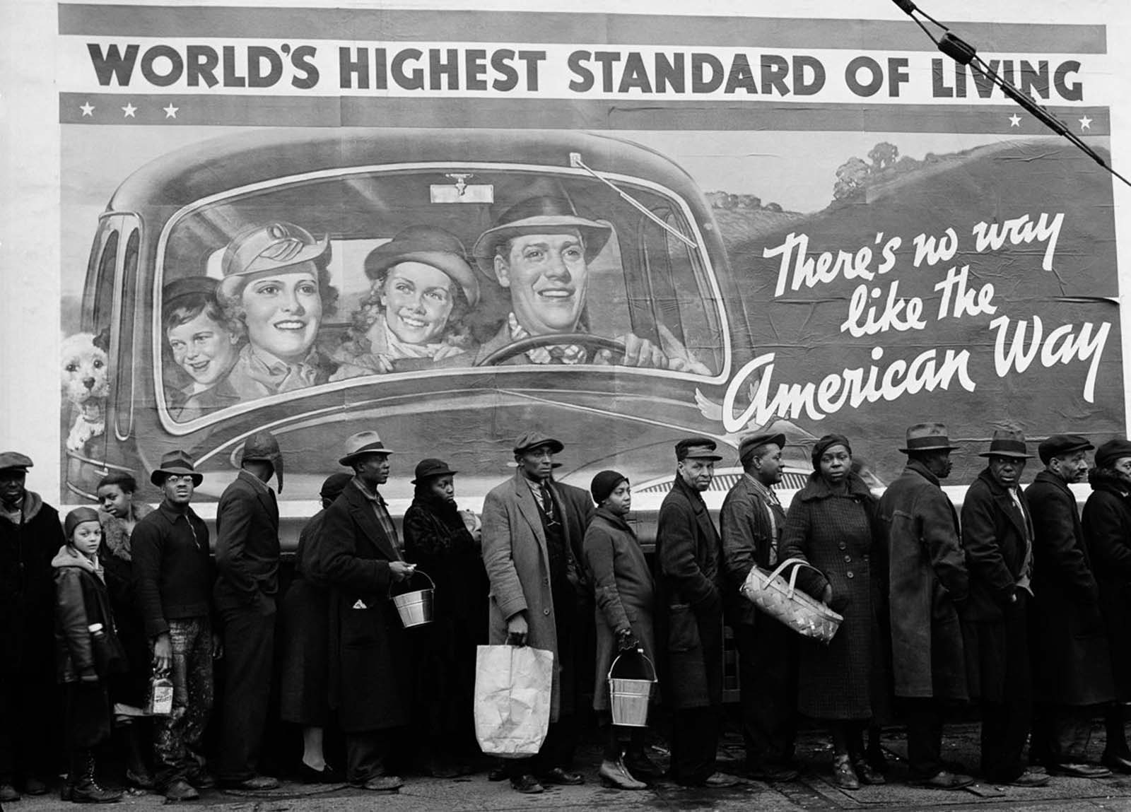 African-Americans displaced by the Great Ohio River Flood line up at a relief station in Louisville, Kentucky. 1937.