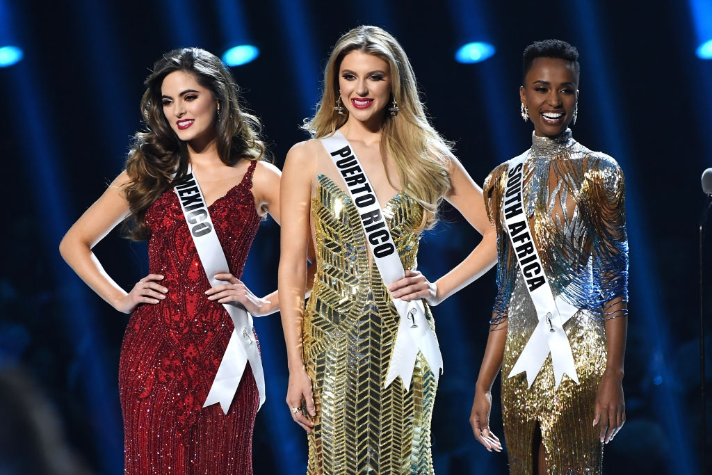 Miss Mexico Sofía Aragón, Miss Puerto Rico Madison Anderson and Miss Universe 2019 Zozibini Tunzi, of South Africa, appear onstage at the 2019 Miss Universe Pageant at Tyler Perry Studios on December 08, 2019 in Atlanta, Georgia. (Photo by Paras Griffin/Getty Images)