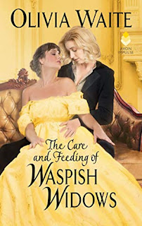 Lesbian in black coat embracing woman in yellow dress