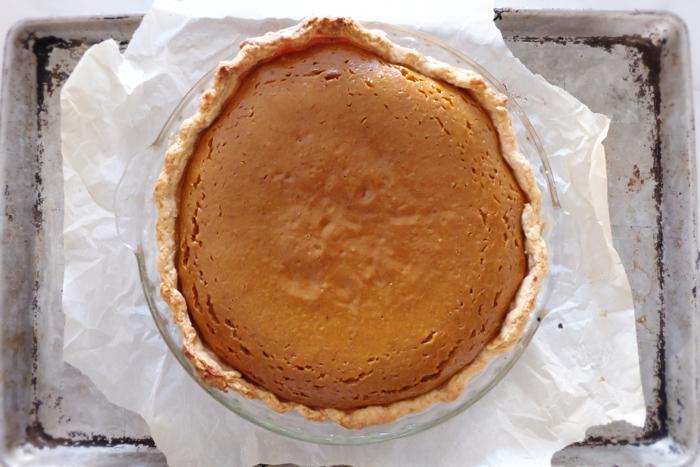 baked pumpkin pie on baking sheet
