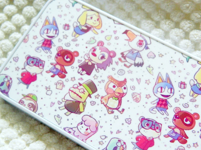 A photograph of an Animal Crossing phone case featuring lots of cute animal characters